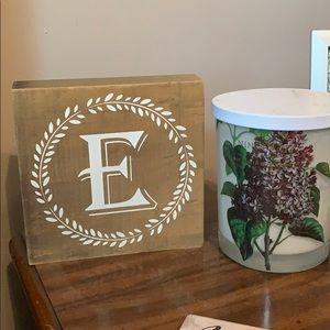 "Wooden Block ""E"" sign"